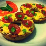 Pizza Bagel: pizza sauce melted cheese, pepperoni, green peppers
