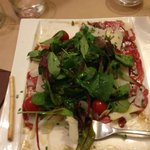 Beef carpaccio with shaved parmesan and salad