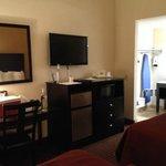 Flatscreen, fridge and desk