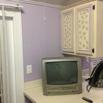 Old TV and kitchen cabinet