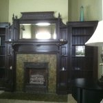 Fireplace and library in Roehm House Queen Exec suite