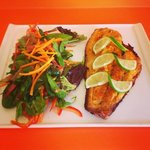 Red Snapper Filet served with Salad & Fried Green Plantain.   Filete de Pargo Rojo acompanado co
