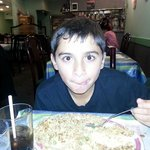 My kid eating Chicken Fried Rice.