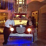 Us two outside hotel lobby with decorated model car