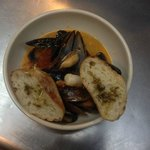 Mussels, Shrimps and Chorizo in a Coconut Red Curry and Ginger Broth with Crusty Garlic Bread