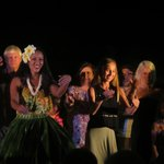 Audience doing hula with performers