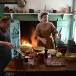 Volunteer, Becky Manley demonstrating Hearth Cooking at Easter on the Farm 2013.