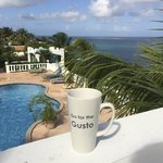 Morning coffee on the upper pool house balcony