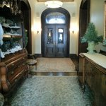 Beautiful entryway with antique furniture-and a little model of an old timey town for the holida