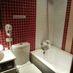 Tiny toilet with tiny bathtub