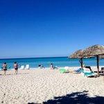 Lovely beach with kayak and chair .Nice beach!