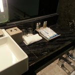 The basin with toiletries in the bathroom