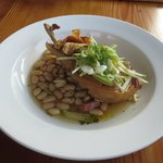 Berkshire Pork with White Beans, Kipfler Chips, and Speck and Cider Broth
