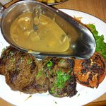 Ribye steak with champignon sauce .