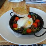 Baked eggs, tomatoes and sour dough
