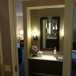 vanity station between bedroom and bathroom