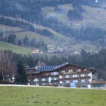 view of hotel from a distance w/kids ski area in front