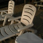 "see the "" black stains"" on these plastic  beach chairs, the back is very hard to ajust"