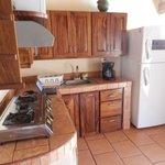 The kitchen with full-size fridge/freezer
