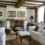Willows` End -welcoming lounge with woodburning stove
