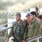 Ron Lev with soldiers on the Jordan River