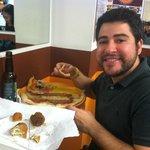 My husband enjoying the pizza and arancini at Zizzi