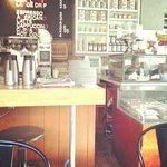 Café counter. Good coffee, great brunch, super addictive granola