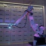 Luggage storage robot arm