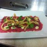 Beef carpaccio, lobster cracklings, horseradish, mustard, smoked olive oil