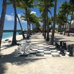 Giant chess board with our beachfront restaurant in the distance