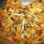 Fungi Pizza with very thin crust, crispy and nice
