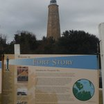 1 of the 6 Information boards outside the visitor centre with the old Lighthouse behind
