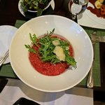 Beetroot and Rosemary Risotto topped with Rocket and Parmesan