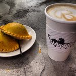 Chicken empanadas and latte