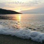 Strand und Sonnenuntergang