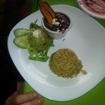 Veggies, rice and sauce to accompany chicken fajita