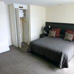 A 2 hanger wardrobe!,1 bedside unit!