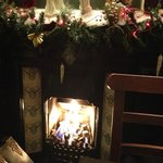 The fire decorated for Christmas (from my December visit)