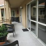 Outside of studio unit showing glassed windows/door