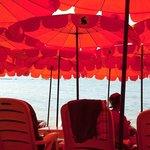 Under the beach umbrellas
