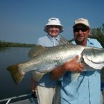 This barra was so heavy she needed help from the guide to hold it!