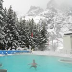 VIEW AT THE OUTDOOR HEATED POOL OF HOTEL MERCURE BRISTOL LEUKERBAD.