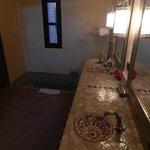 Hude bathroom with sunken bath