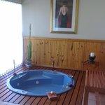 jacuzzi with sliding door to pool