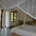 mosquito net folded away around bed - every evening we returned to find it fully deployed