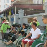 outside the hotel, senior citizens waiting for the cyclo tour of their lifetime :P