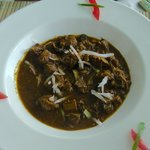 Goat meat cooked in curry & coconut milk