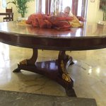 Ornate, elliptical table in lobby