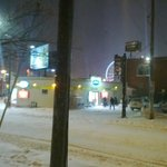 Convenience store across the street the night of heavy snow