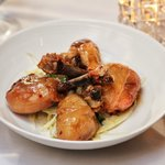 Crispy Chicken Drumsticks. Honey-garlic glaze, lemon, parsley over endive